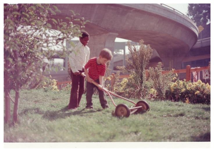 cene from Crossroads Community (the farm) - Boys Mowing The Lawn © 1976 Bonnie Ora Sherk